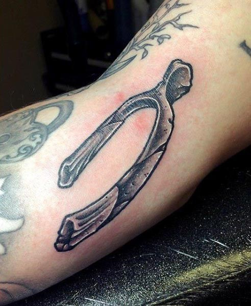 Black and gray style small arm tattoo of bone