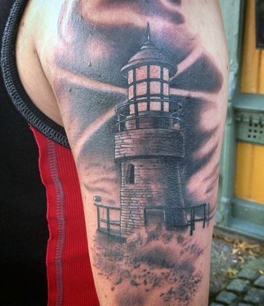 Black and gray style small old lighthouse and waves tattoo on shoulder