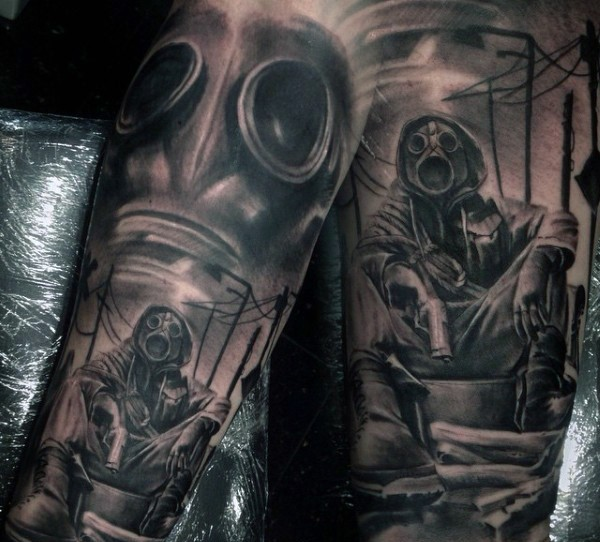Black and gray style spectacular looking forearm tattoo of soldier in gas mask