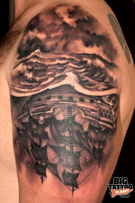 Black and gray style underwater sailing ship tattoo on shoulder