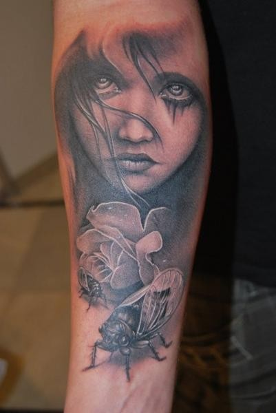 Black and gray style very detailed forearm tattoo fo girl portrait and various insects