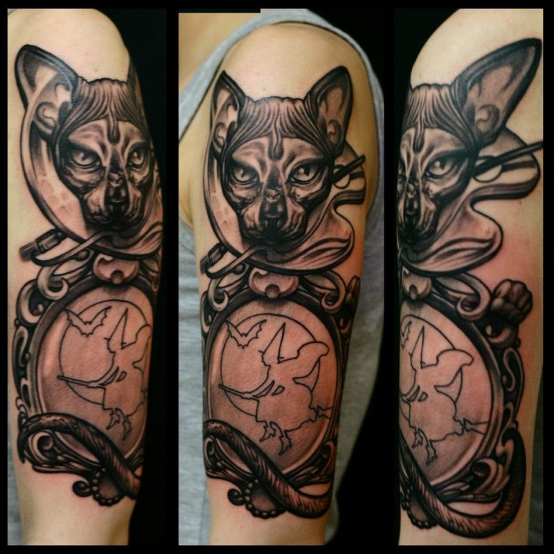 Black and gray style very detailed shoulder tattoo of cute cat with mirror
