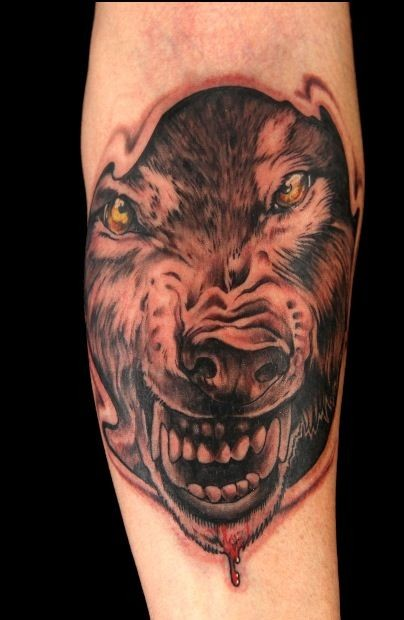Black and gray style wolf face tattoo with yellow eyes