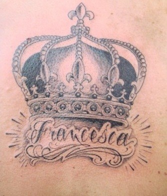 Black and white crown tattoo