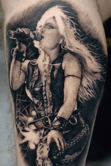 Black and white detailed biceps tattoo of woman singer