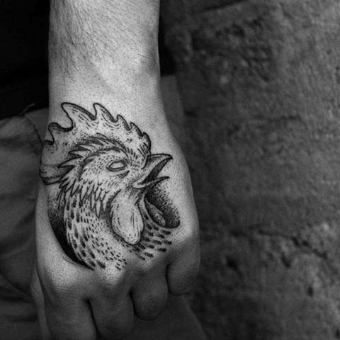 Black and white detailed peacock head hand tattoo