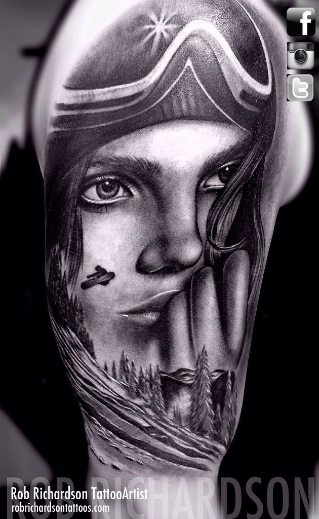 Black and white detailed shoulder tattoo of cute gird and snowboarder