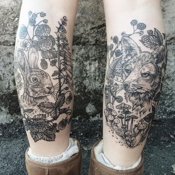 Black and white engraving style black ink legs tattoo of rabbit with fox and mushrooms