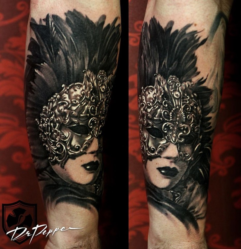 Black and white forearm tattoo of woman in mystic mask