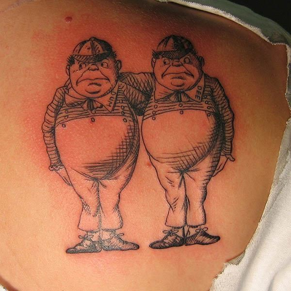 Black and white funny identical man tattoo on back