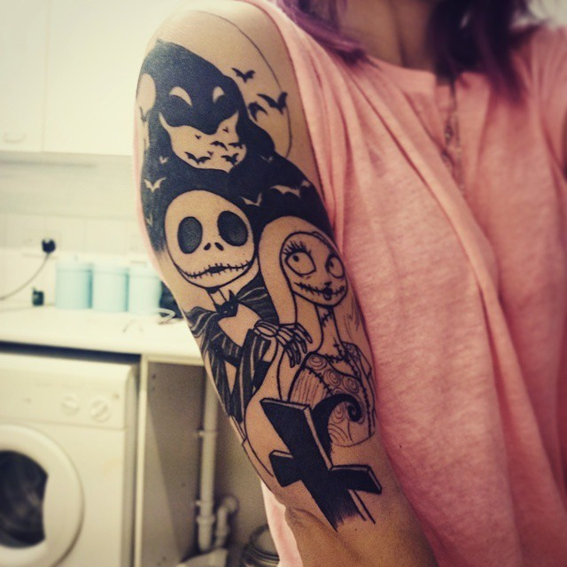 Black and white homemade black ink monster cartoon couple tattoo on shoulder with bats