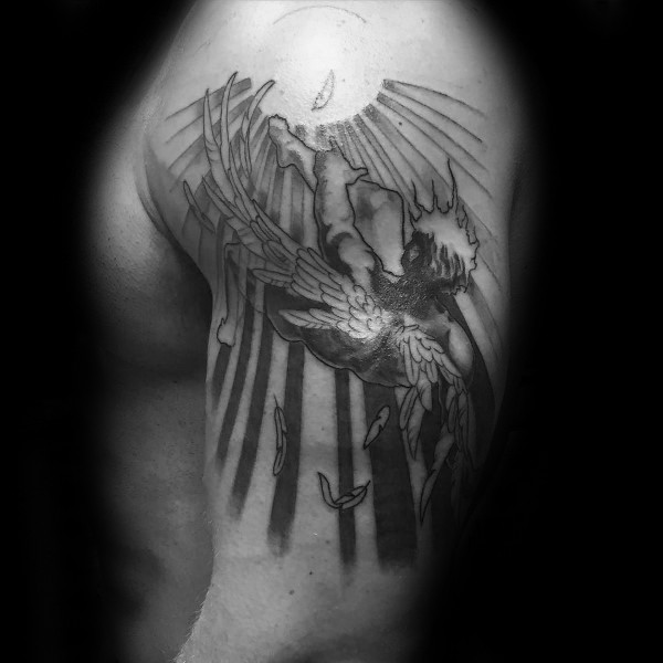 Black and white large shoulder tattoo of burning Icarus