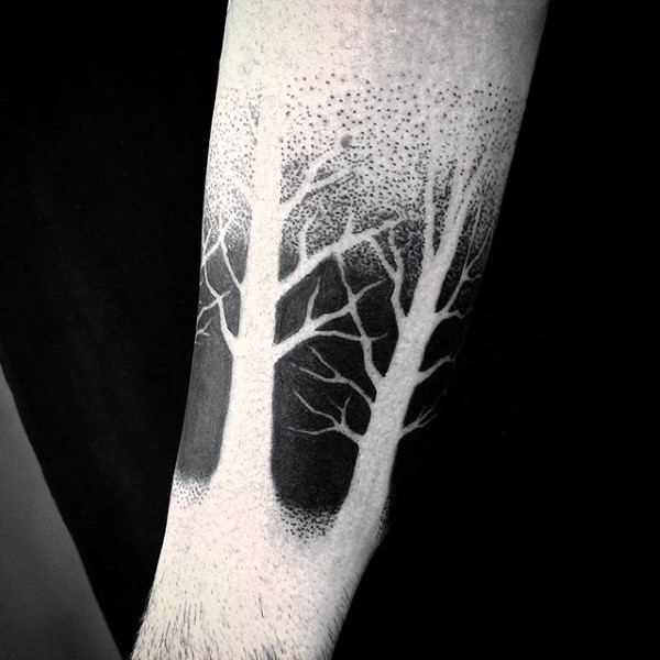 Black and white leafless trees tattoo with partly dotted work technique