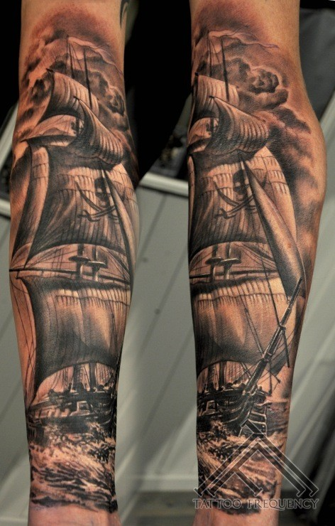 Black and white realism style very detailed forearm tattoo of pirate sailing ship