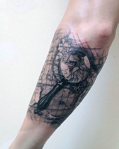 Black and white realistic lope with world map tattoo on arm black and white realistic lope with world map tattoo on arm gumiabroncs Image collections