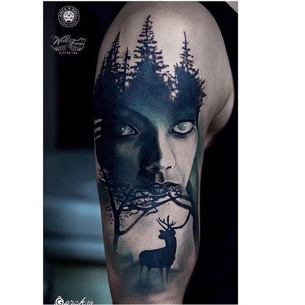 Black and white shoulder tattoo of mystical woman with dark forest