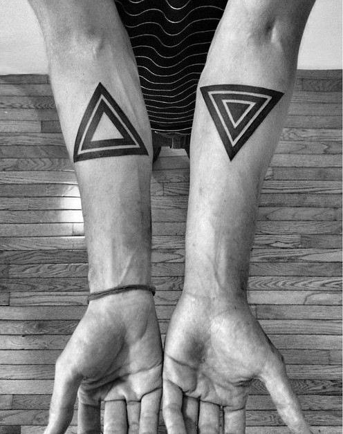 Black and white triangles tattoo on both forearms in geometry style