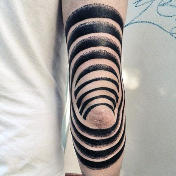 Black and white tribal tattoo on elbow