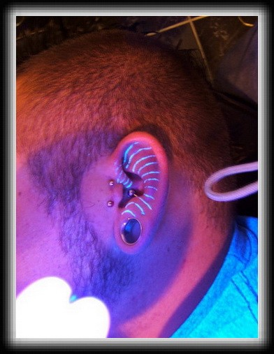 Black brackets light tattoos on ear
