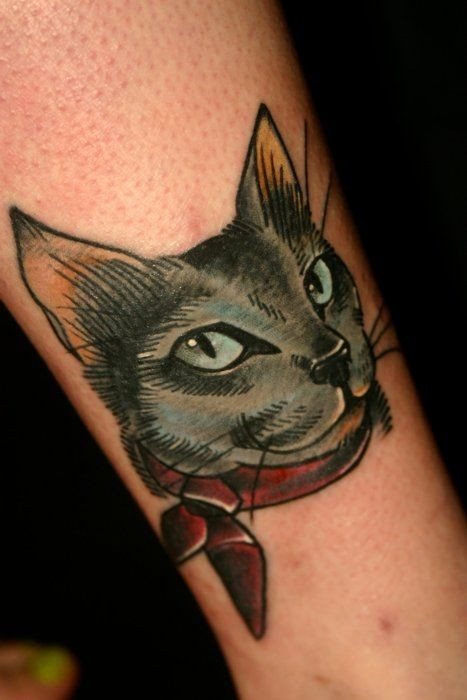 Black cat with red neck scarf tattoo