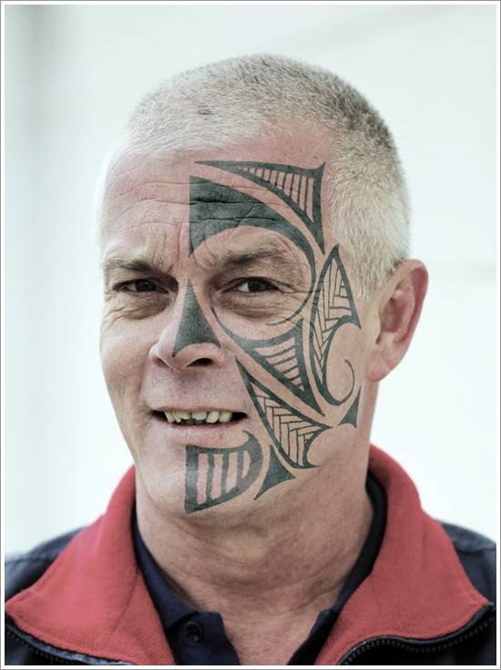 Black celtic face tattoo design