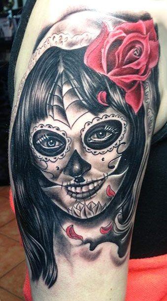 Black creepy santa muerte girl with red rose tattoo
