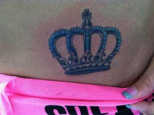 Black crown with blue pearls tattoo