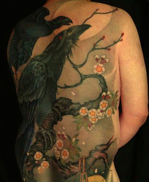 Black crows on a flowering tree tattoo