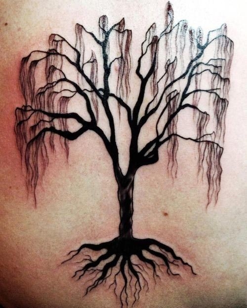Black dead tree with roots tattoo