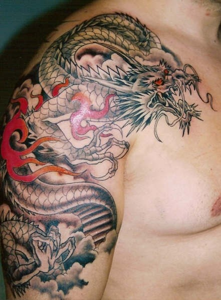 Black dragon with red eyes in japanese style tattoo on shoulder