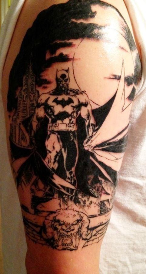 Black gray batman tattoo on arm