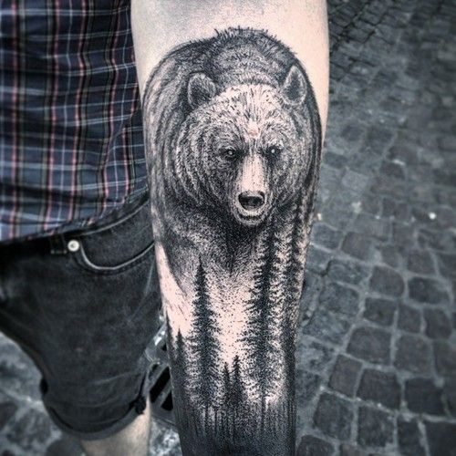 Black gray bear and forest forearm tattoo