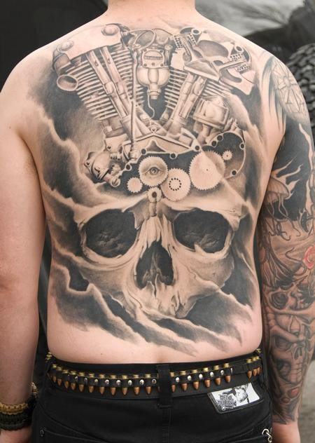 Black gray big skull with various mechanisms tattoo on back