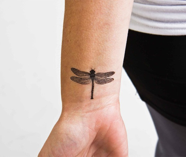Black gray dragonfly tattoo on wrist