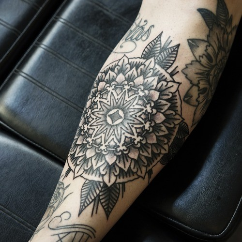 Black gray floral patterns forearm tattoo