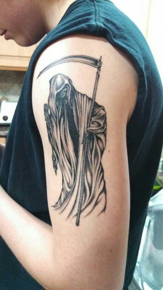 Black gray ink grim reaper tattoo on shoulder