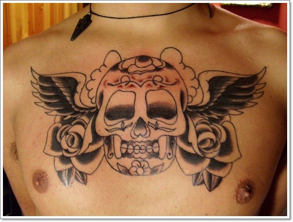 Black gray mexican sugar skull with roses tattoo on chest