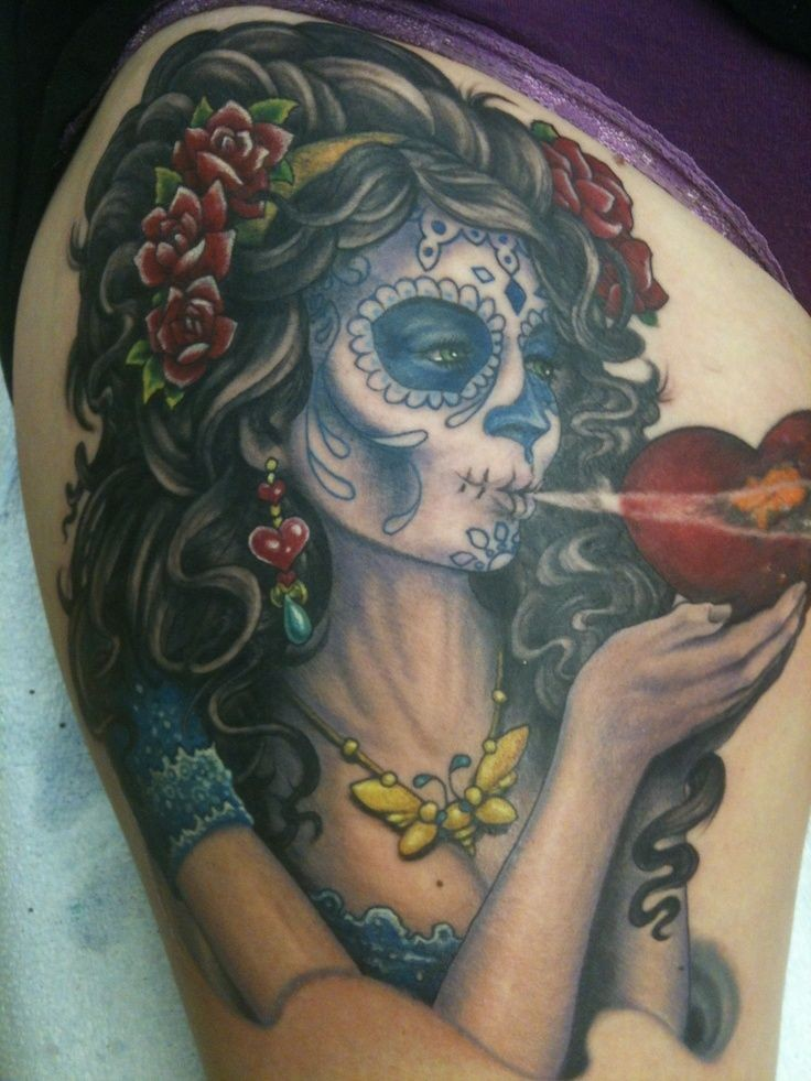 Black haired santa muerte girl with red heart in hands tattoo