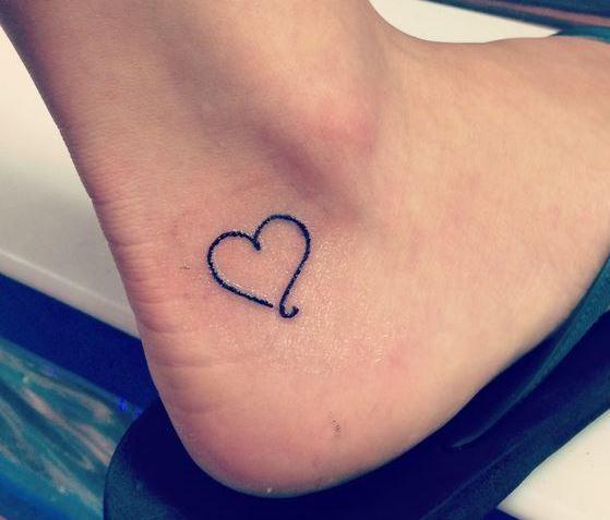 Black heart shape small ankle tattoo