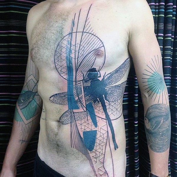 Black ink abstract style big dragonfly tattoo on chest and belly