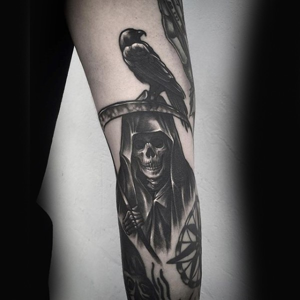 Black ink arm tattoo of Grimm reaper with crow