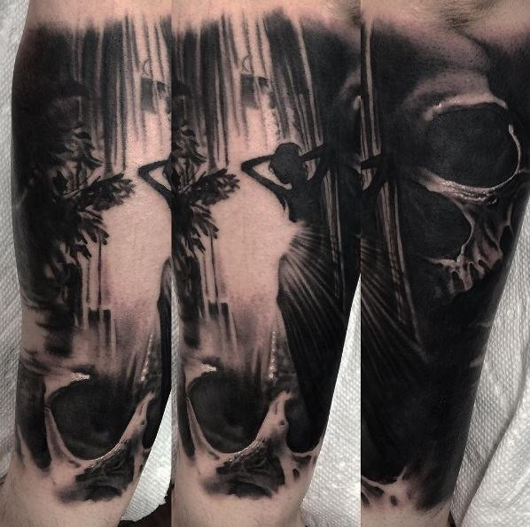 Black ink arm tattoo of human skull with woman figure