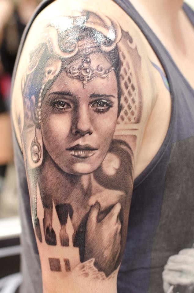 Black ink awesome looking shoulder tattoo of beautiful woman