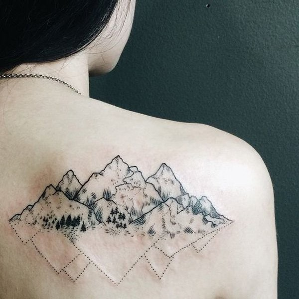 Black ink back tattoo of mountains with lines