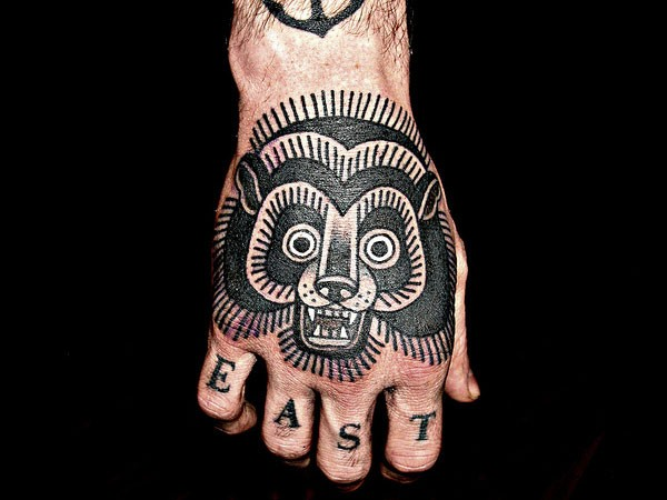 Black ink bear tattoo on hand