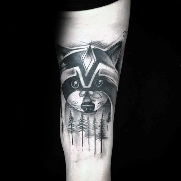 Black ink beautiful looking arm tattoo of raccoon face with forest