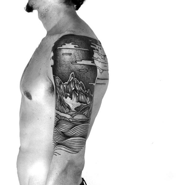 Black ink beautiful painted shoulder tattoo of mountains and waves