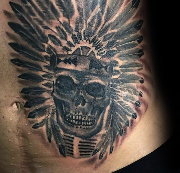 Black ink belly tattoo of Indian skull with helmet