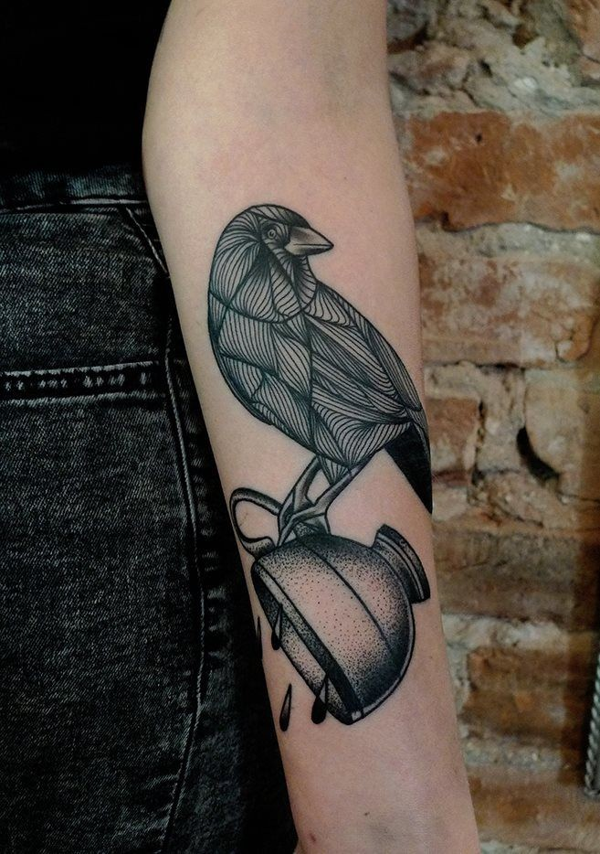 Black ink bird and teacup forearm tattoo