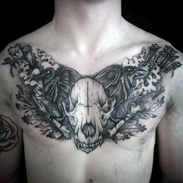 Black ink chest tattoo of animal skull with crows